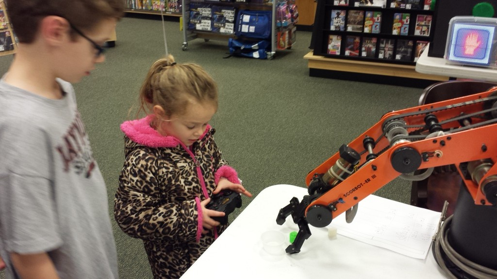 4 year old operating the robot arm like a pro!