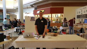 Brad Powers demonstrates 3D printing, electronics, and answers greets the public